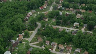 AX105_090 - 5K stock footage aerial video of suburban homes and quiet streets, Penn Hills, Pennsylvania