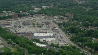 AX105_091 - 5K stock footage aerial video orbiting a strip mall and Parking Lot, Penn Hills, Pennsylvania