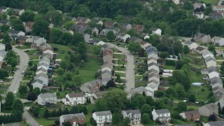 AX105_094 - 5K stock footage aerial video orbiting a suburban neighborhood, Penn Hills, Pennsylvania