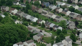 AX105_095 - 5K stock footage aerial video orbiting suburban homes, Penn Hills, Pennsylvania