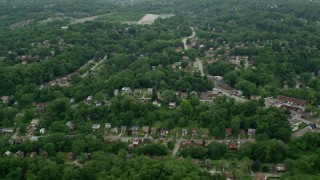 AX105_098 - 5K stock footage aerial video flying over suburban neighborhoods, Penn Hills, Pennsylvania