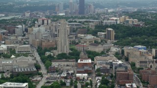 AX105_105 - 5K stock footage aerial video of Cathedral of Learning, University of Pittsburgh, Pennsylvania