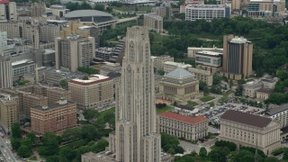 AX105_106 - 5K stock footage aerial video orbiting the Cathedral of Learning, University of Pittsburgh, Pennsylvania
