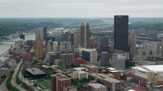 AX105_110 - 5K stock footage aerial video orbiting skyscrapers, Downtown Pittsburgh, Pennsylvania
