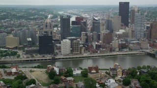 AX105_116 - 5K stock footage aerial video of riverfront skyscrapers, Downtown Pittsburgh, Pennsylvania