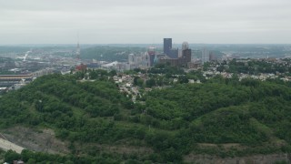 AX105_119 - 5K stock footage aerial video approaching suburban homes, Pittsburgh, Pennsylvania