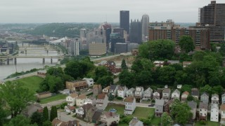 AX105_121 - 5K stock footage aerial video approaching skyscrapers and park fountain, Downtown Pittsburgh, Pennsylvania