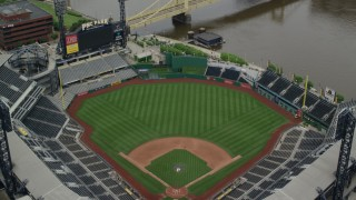 AX105_124 - 5K stock footage aerial video orbiting PNC Park Tilt Up and Reveal Downtown Pittsburgh, Pennsylvania