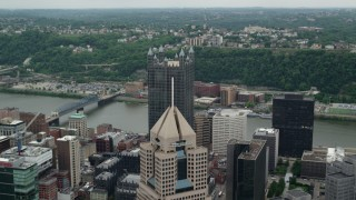 AX105_129 - 5K stock footage aerial video flying over skyscrapers, Downtown Pittsburgh, Pennsylvania