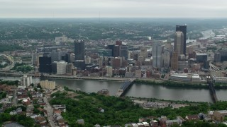 AX105_134 - 5K stock footage aerial video approaching riverfront skyscrapers, Downtown Pittsburgh, Pennsylvania