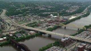 AX105_139 - 5K stock footage aerial video flying over bridges toward HJ Heinz Plant, Pittsburgh, Pennsylvania