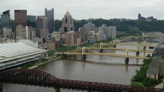 AX105_153 - 5K stock footage aerial video of bridges spanning river, Downtown Pittsburgh, Pennsylvania