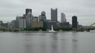 AX105_162 - 5K stock footage aerial video approaching a fountain at Point State Park, Downtown Pittsburgh, Pennsylvania