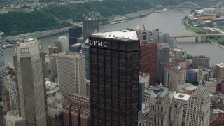 AX105_183 - 5K stock footage aerial video flying over U.S. Steel Tower, Downtown Pittsburgh, Pennsylvania