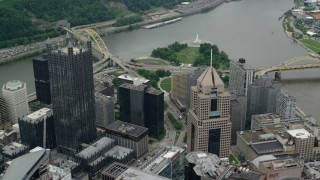 AX105_184 - 5K stock footage aerial video flying over skyscrapers and approaching Point State Park, Downtown Pittsburgh, Pennsylvania