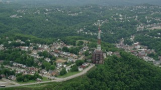 AX105_186 - 5K stock footage aerial video of a radio tower in a suburb, Pittsburgh, Pennsylvania