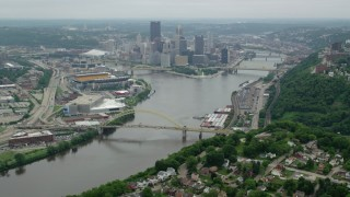 AX105_193 - 5K stock footage aerial video approaching skyscrapers and rivers, Downtown Pittsburgh, Pennsylvania