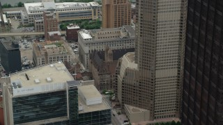 AX105_202 - 5K stock footage aerial video tilting up from Allegheny County Courthouse to BNY Mellon Center, Downtown Pittsburgh, Pennsylvania