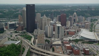 AX105_203 - 5K stock footage aerial video of skyscrapers and convention center, Downtown Pittsburgh, Pennsylvania