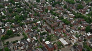 AX105_206 - 5K stock footage aerial video flying over residential town houses, Pittsburgh, Pennsylvania