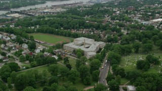 AX105_208 - 5K stock footage aerial video flying over high school, Pittsburgh, Pennsylvania