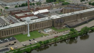 AX105_212 - 5K stock footage aerial video orbiting Western State Penitentiary, Pittsburgh, Pennsylvania