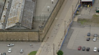 AX105_217 - 5K stock footage aerial video orbiting a guard tower at Western State Penitentiary, Pittsburgh, Pennsylvania