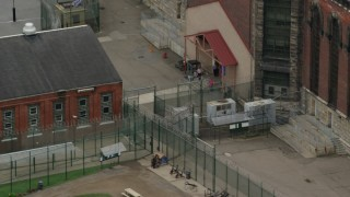 AX105_218 - 5K stock footage aerial video of Chain Link Fence and Guards at Western State Penitentiary, Pittsburgh, Pennsylvania