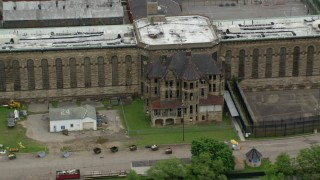 AX105_220 - 5K stock footage aerial video of an old building at Western State Penitentiary, Pittsburgh, Pennsylvania