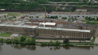 AX105_221 - 5K stock footage aerial video orbiting Western State Penitentiary, Pittsburgh, Pennsylvania