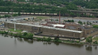 AX105_222 - 5K stock footage aerial video orbiting Western State Penitentiary, Pittsburgh, Pennsylvania