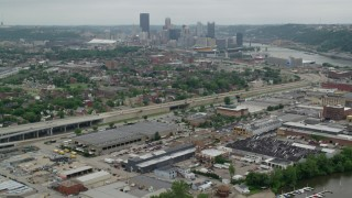 AX105_224 - 5K stock footage aerial video approaching a freeway near Downtown Pittsburgh, Pennsylvania