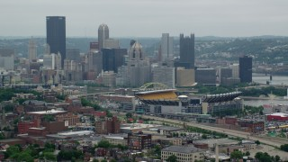 AX105_225 - 5K stock footage aerial video of Heinz Field Football Stadium and Downtown Pittsburgh Skyline, Pennsylvania