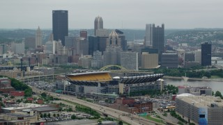 AX105_226 - 5K stock footage aerial video of Heinz Field Football Stadium and Downtown Pittsburgh, Pennsylvania