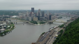 AX105_228 - 5K stock footage aerial video of skyscrapers and rivers in Downtown Pittsburgh, Pennsylvania