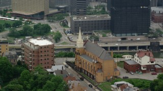AX105_232 - 5K stock footage aerial video orbiting St. Mary of the Mount Church on a Hillside, Pittsburgh, Pennsylvania