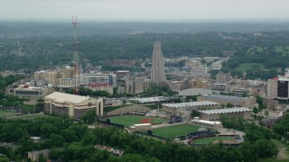 AX105_236 - 5K stock footage aerial video orbiting sports fields at University of Pittsburgh, Pennsylvania