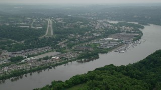 AX105_246 - 5K stock footage aerial video of riverfront office buildings and marina, Pittsburgh, Pennsylvania