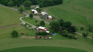 AX105_258 - 5K stock footage aerial video orbiting a ranch house and a red barn, Pittsburgh, Pennsylvania