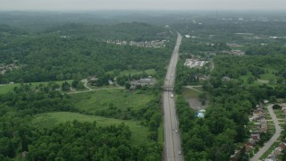 AX105_261 - 5K stock footage aerial video flying over freeway, Pittsburgh, Pennsylvania