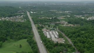 AX105_262 - 5K stock footage aerial video flying over freeways and warehouses, Pittsburgh, Pennsylvania
