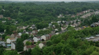 AX105_263 - 5K stock footage aerial video of a quiet neighborhood, Penn Hills, Pennsylvania