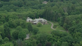 AX106_007 - 5K stock footage aerial video of a mansion by the Woods, Pittsburgh, Pennsylvania