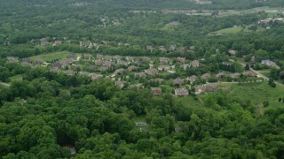 AX106_011 - 5K stock footage aerial video flying over an upscale neighborhood, Allison Park, Pennsylvania