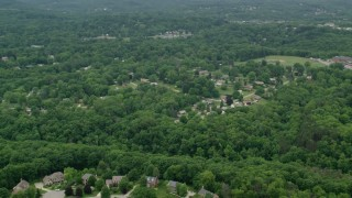 AX106_012 - 5K stock footage aerial video flying over suburban neighborhood, Allison Park, Pennsylvania