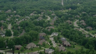 AX106_016 - 5K stock footage aerial video of a mansion in a quiet neighborhood, Allison Park, Pennsylvania