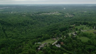AX106_018 - 5K stock footage aerial video of a forest near upscale neighborhood, Gibsonia, Pennsylvania