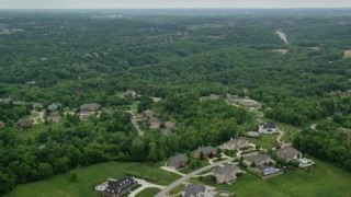 AX106_020 - 5K stock footage aerial video flying over upscale homes near woods, Gibsonia, Pennsylvania