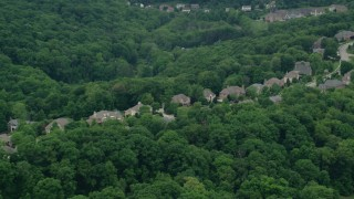 AX106_021 - 5K stock footage aerial video of upscale homes by the woods, Wexford, Pennsylvania