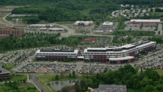 AX106_023 - 5K stock footage aerial video orbiting a modern office building, Cranberry Township, Pennsylvania